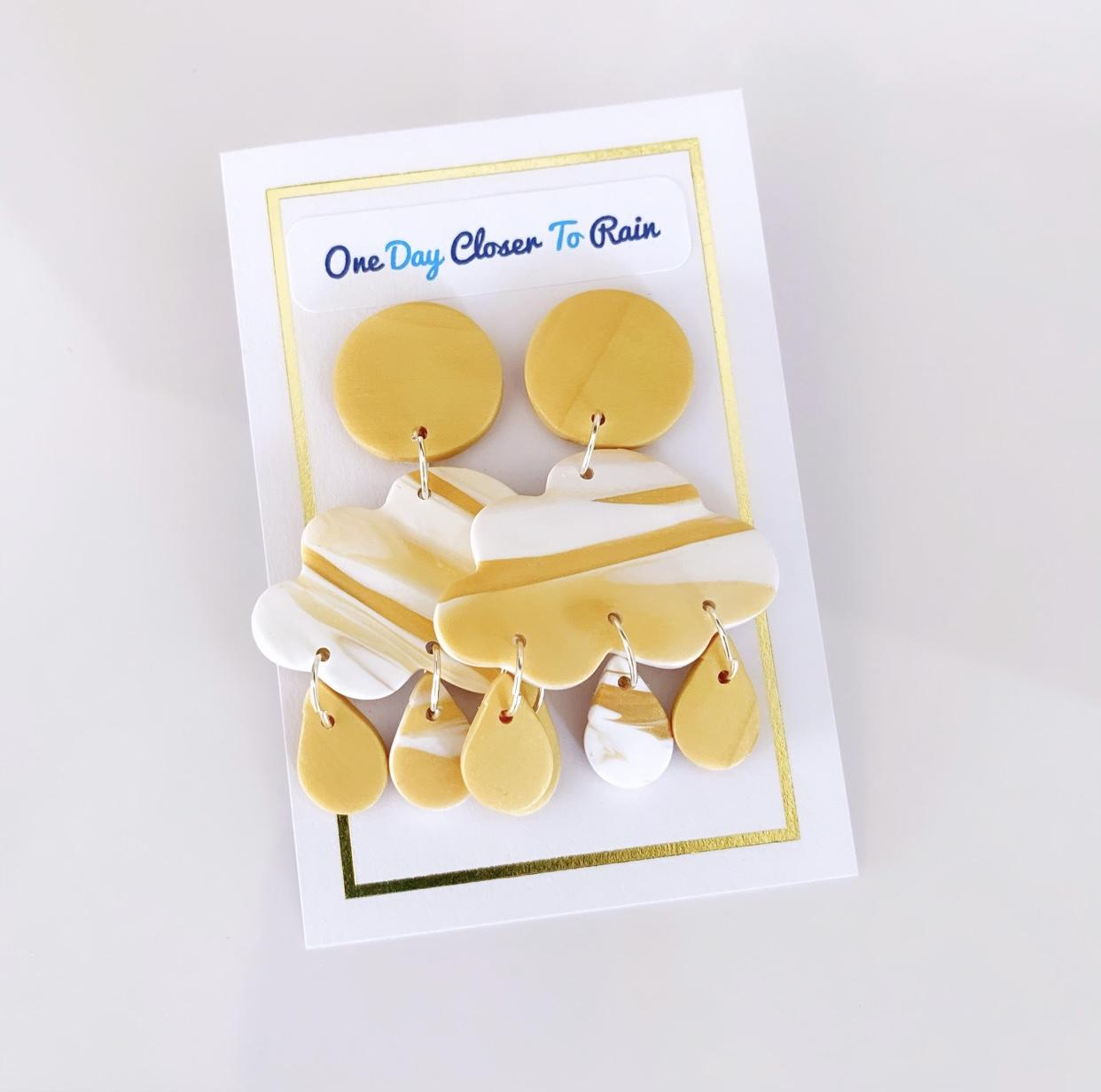 Polymer clay earrings ~ rain clouds purchased are donated to drought relief