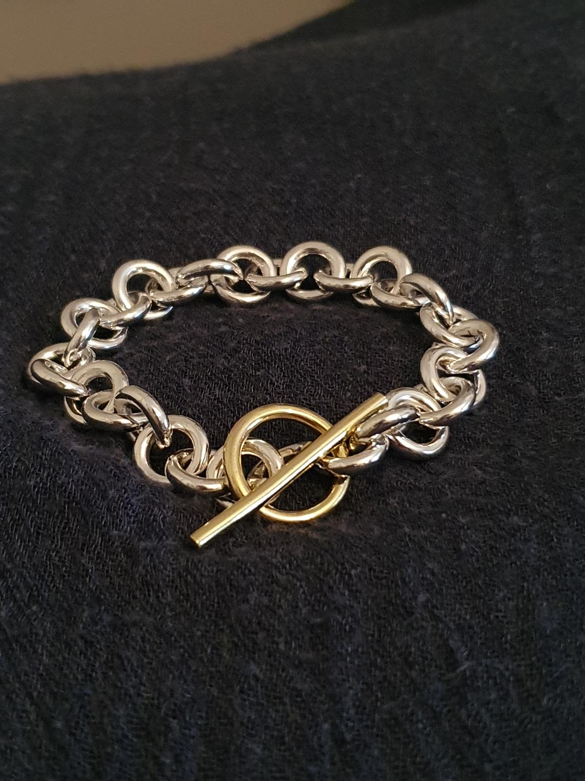 Chunky silver bracelet with brass toggle