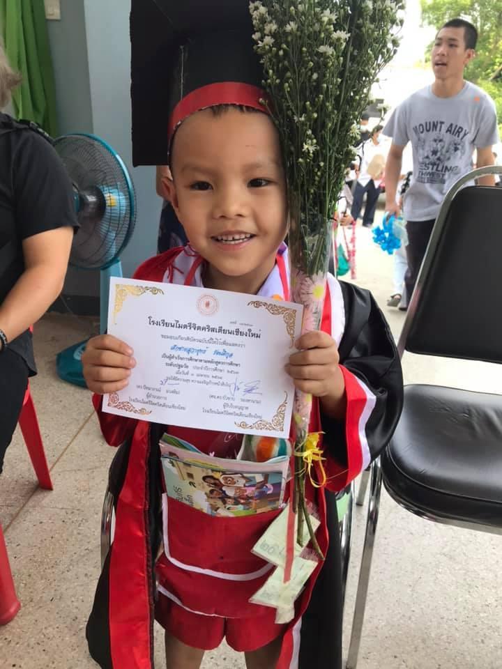 Sponsored child at school graduation