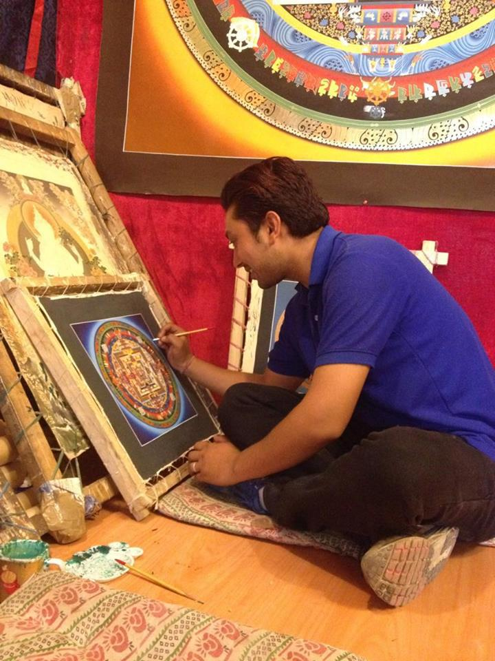 My friend Ravi working on a mandala