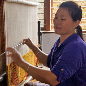 Tibetan woman working at the loom