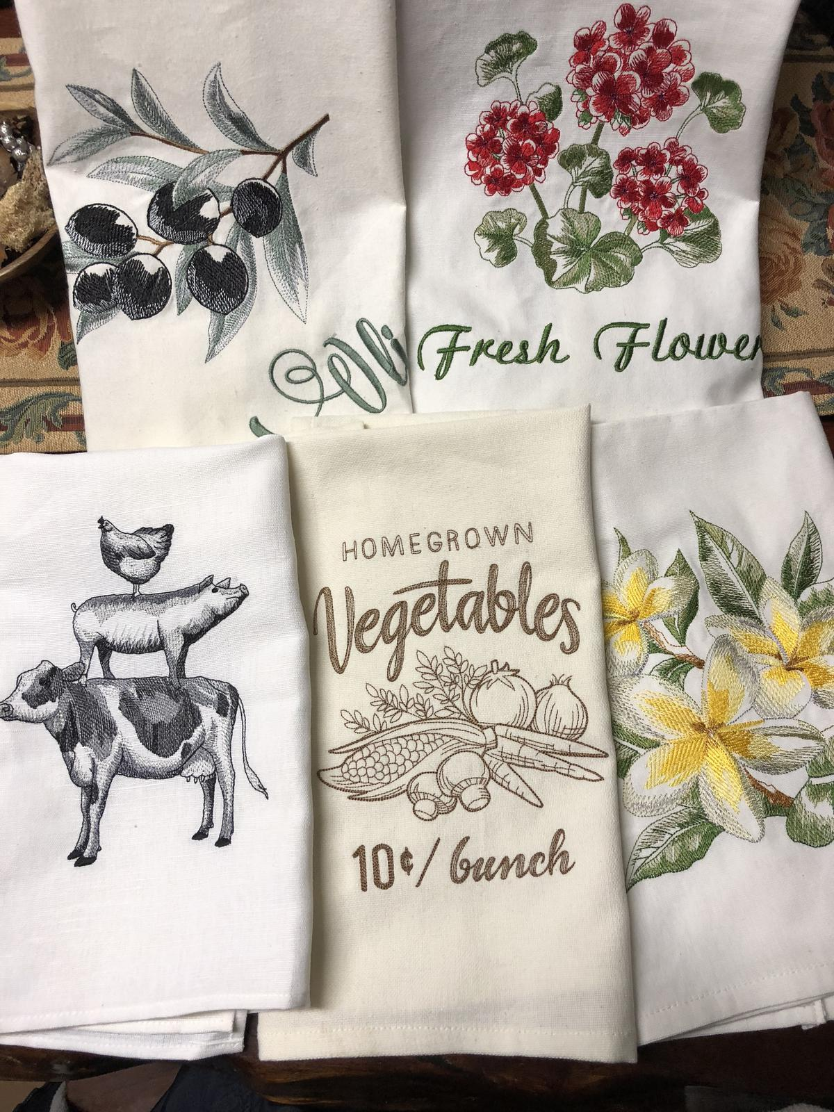 Designs for both tea towels and shopping bags