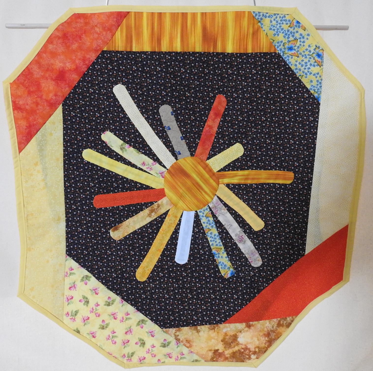 "Hand quilted and embroidered wall hanger ""gratitude sun"""
