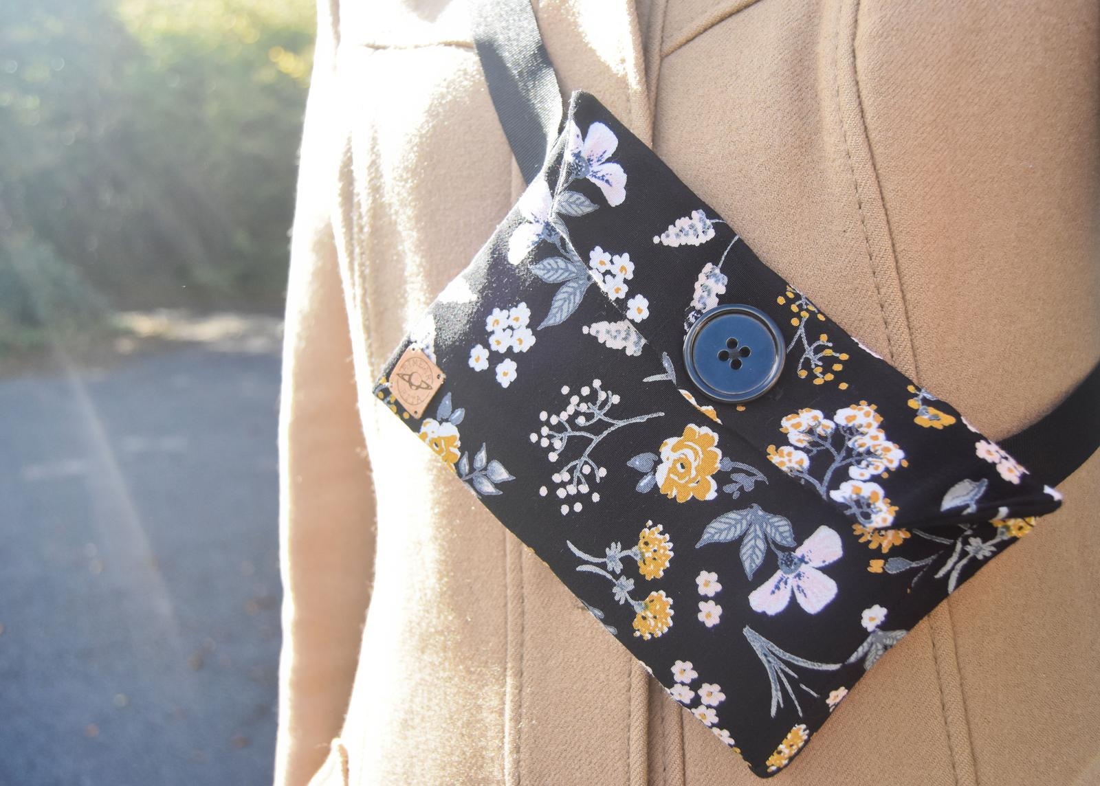 Black floral belt bag, worn cross body