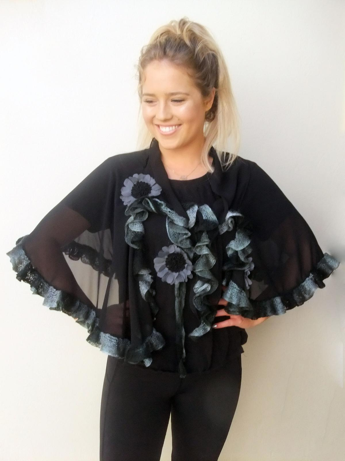 Black Chiffon Cape with flowers and handknitted edge frill.