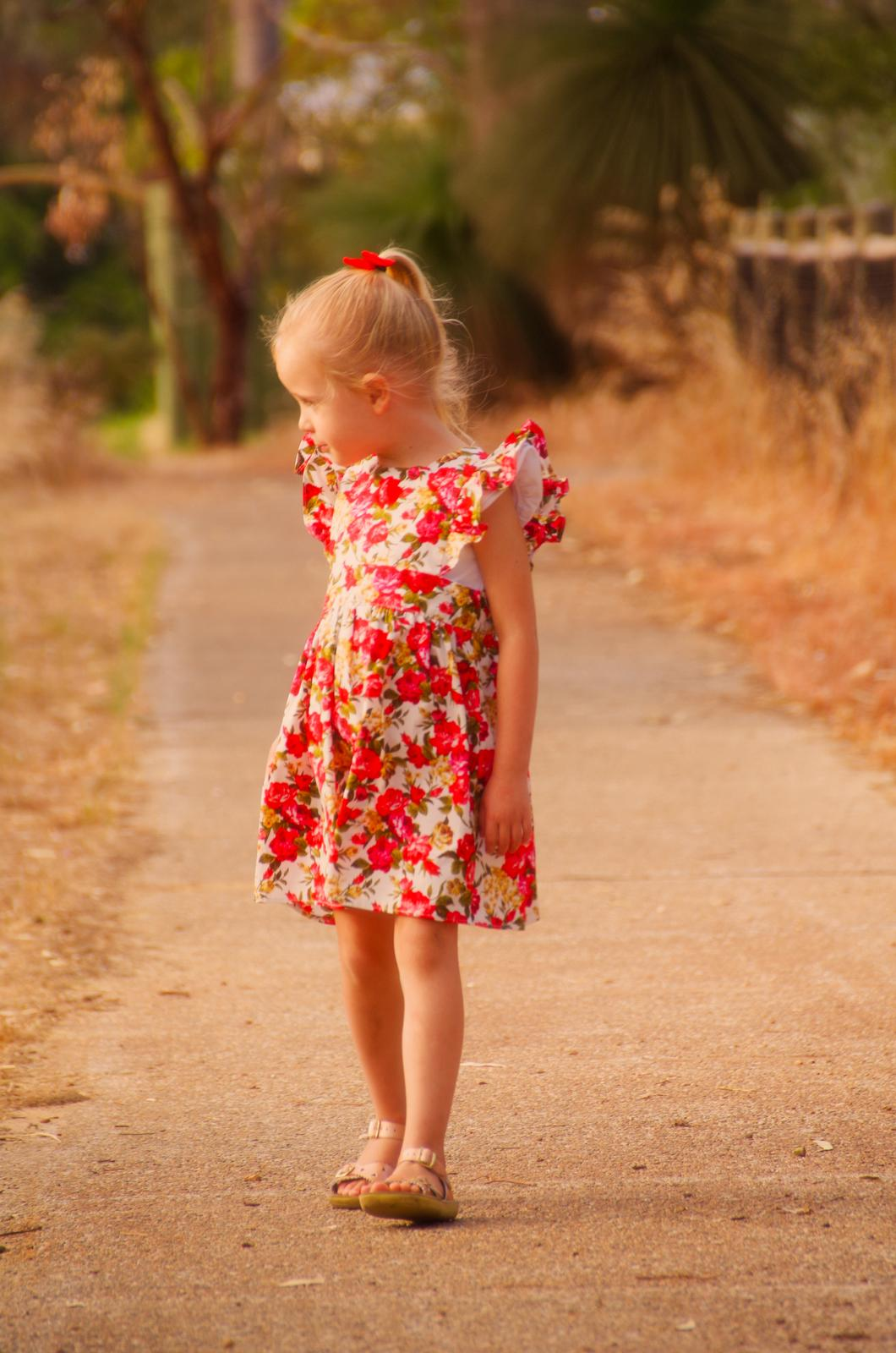 Elsie Ruffle Pinafore - Christmas floral