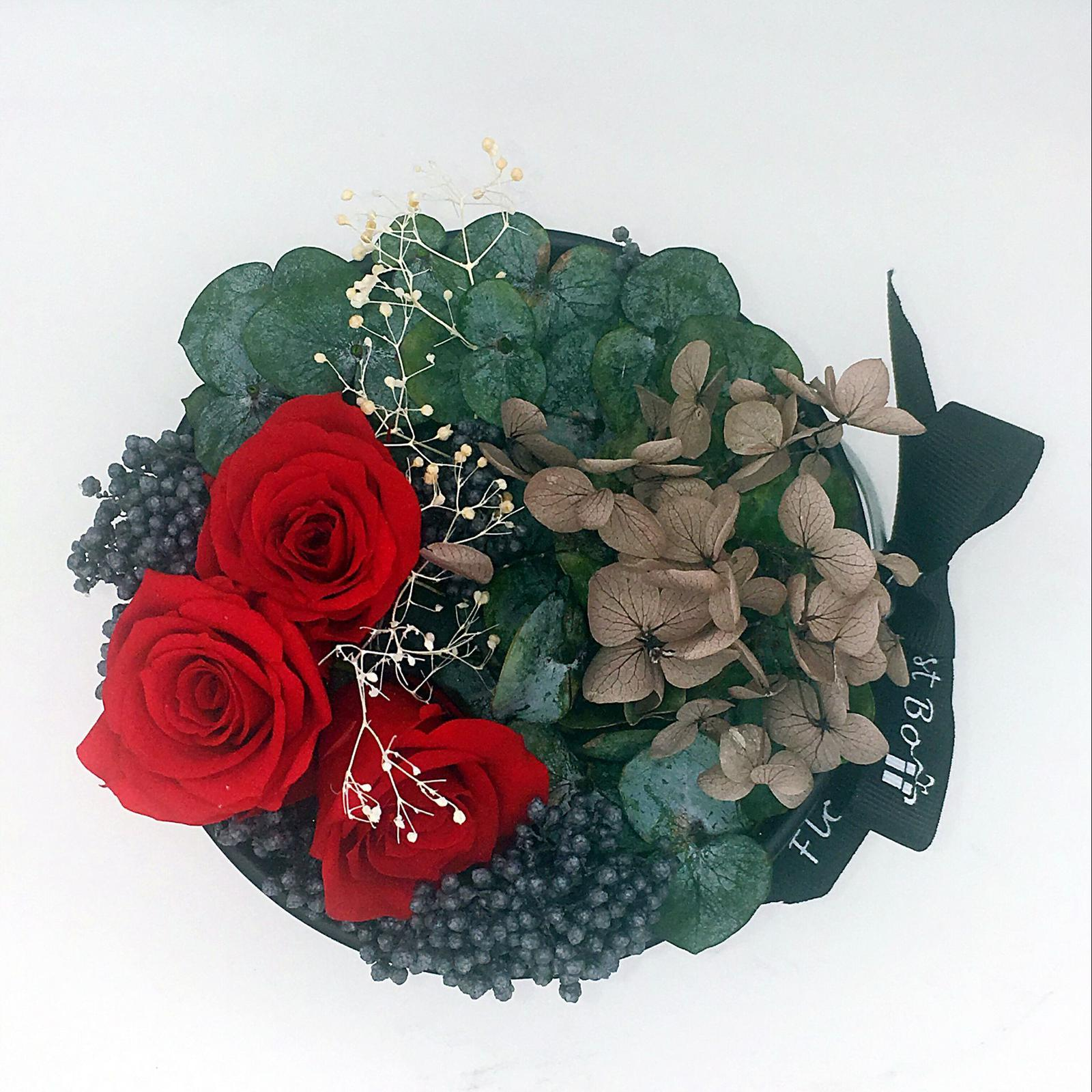 Red rose in a black bucket