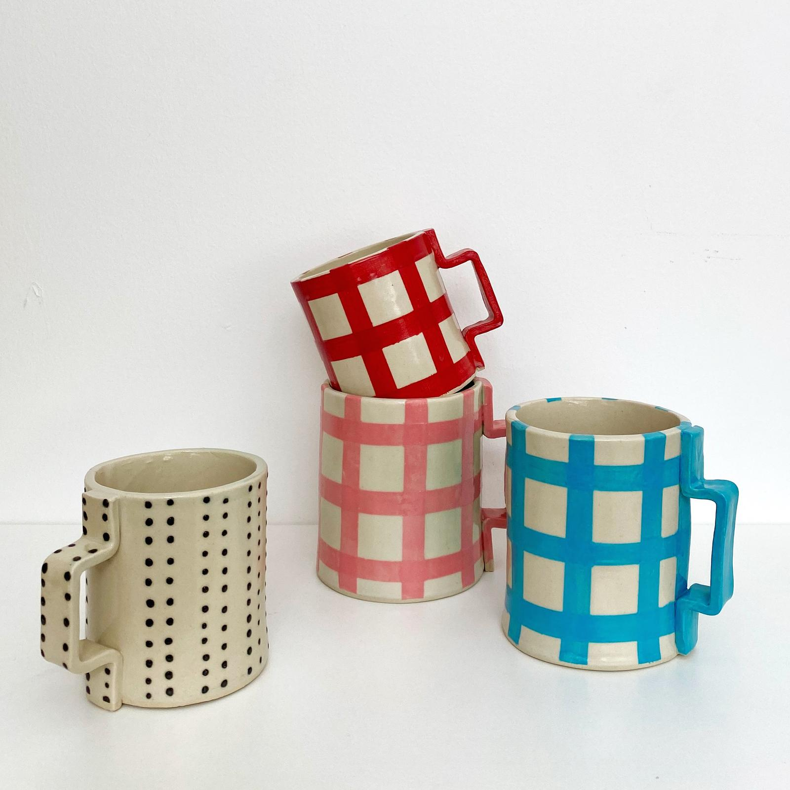 Collection of hand built mugs