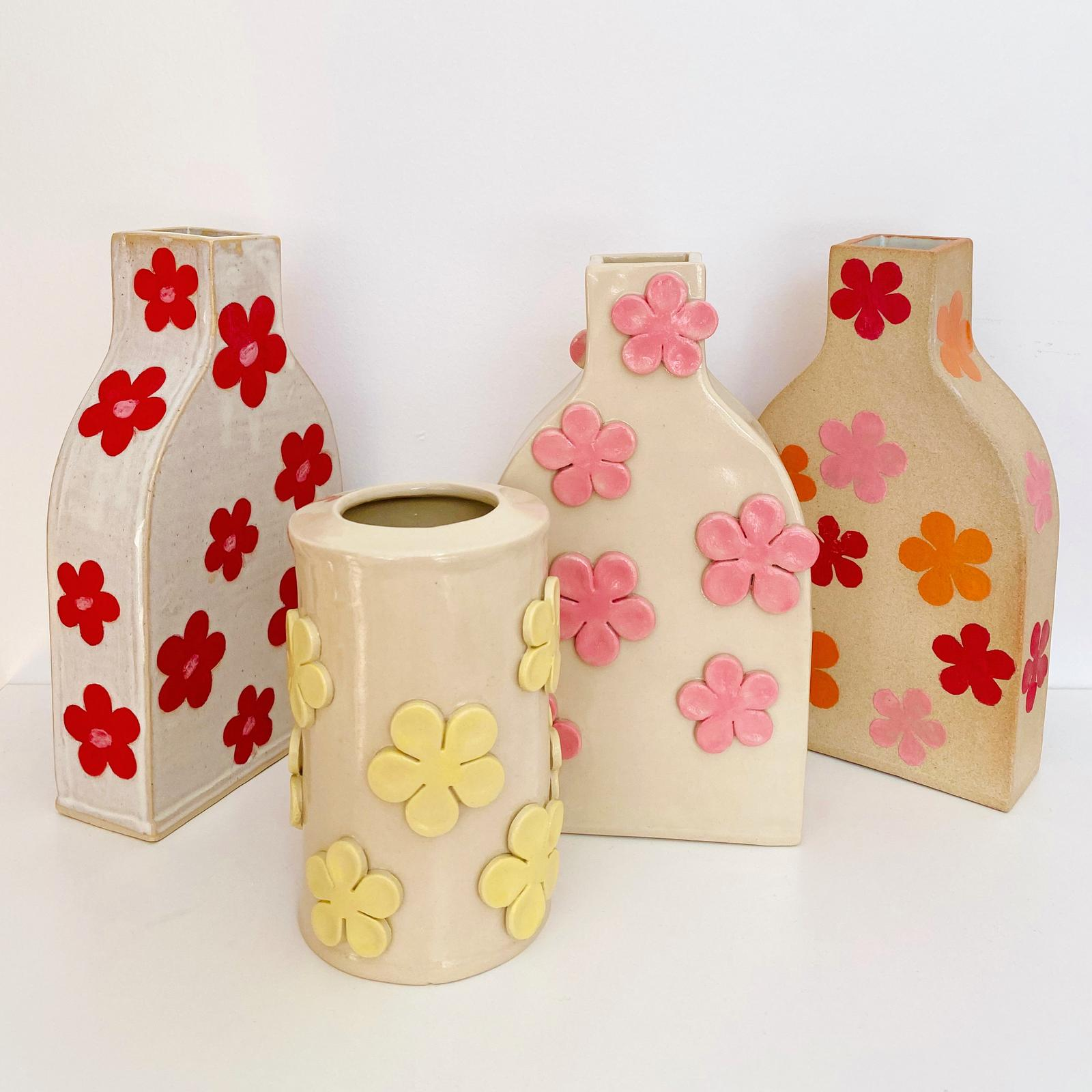 Assortment of vases with 3D flowers and motifs