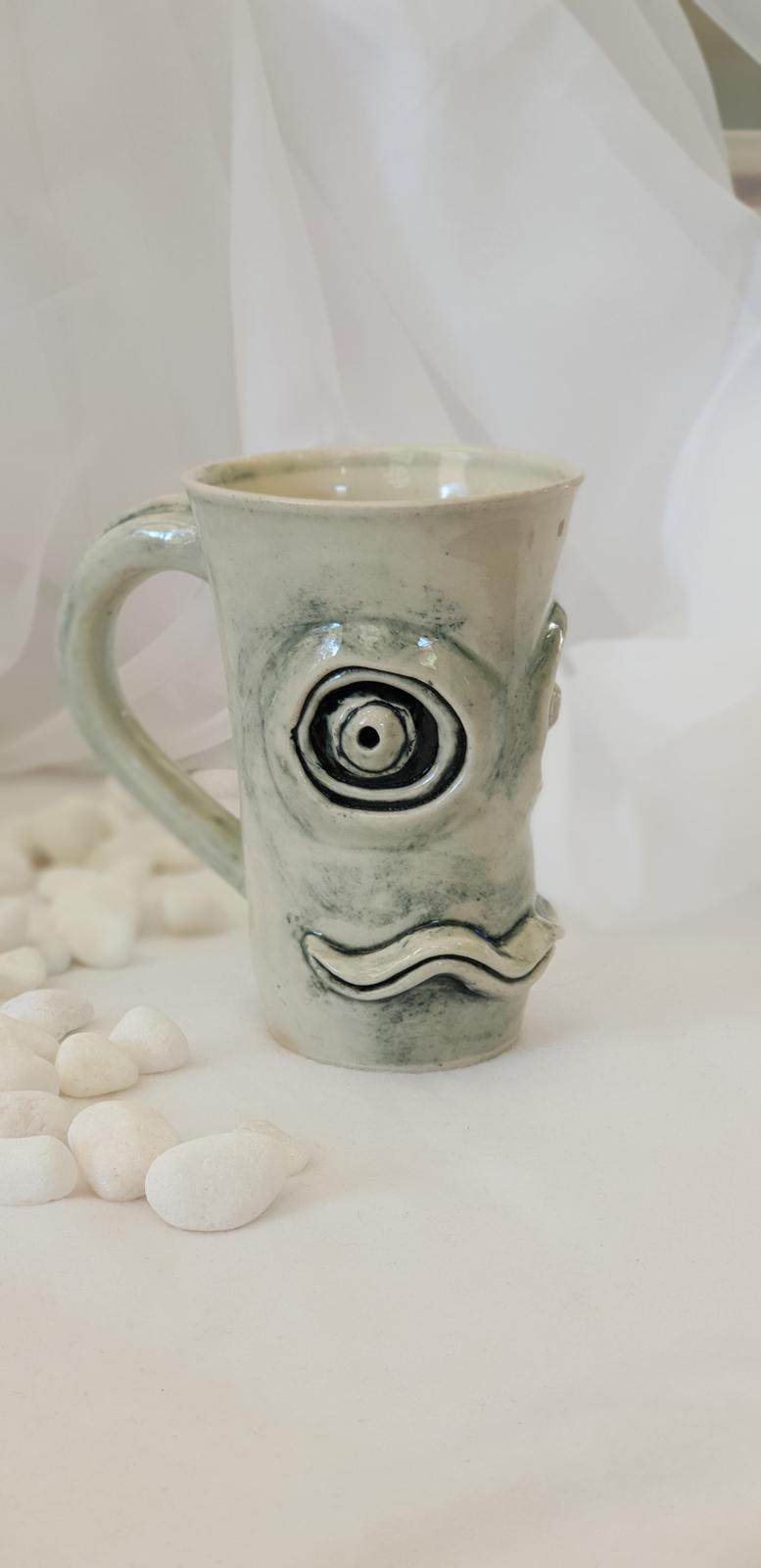 Mugshot! (A selection from a series of hand sculpted character face mugs)