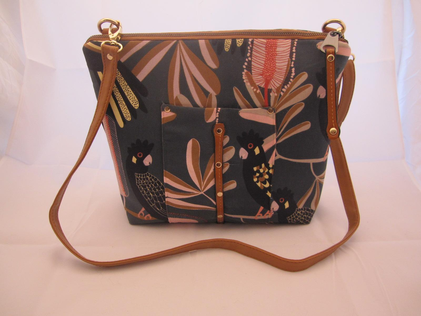 Roomy Tan and leather travel bag