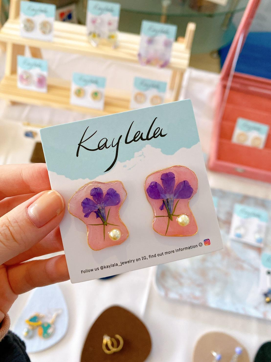 Handmade resin earrings using our own dried flowers