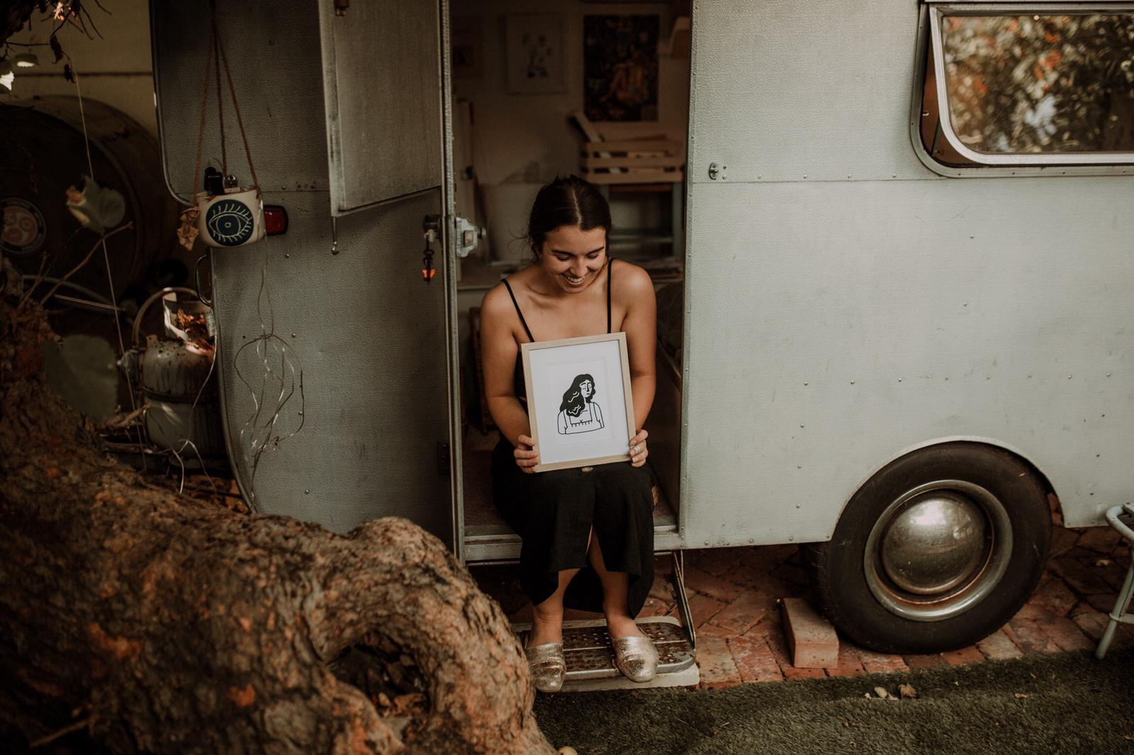 "Kikitsa Draws, Outside caravan-studio, Claudia holding""Woman. Me?"" Framed Print"