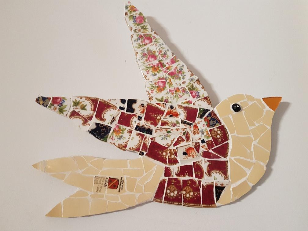 flying mosaic bird