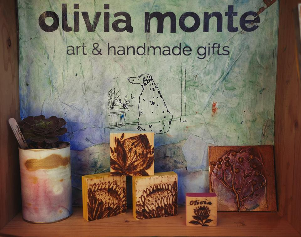 olivia monte stall display and logo