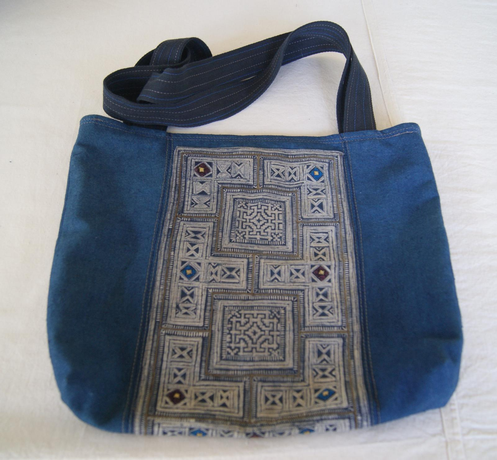 Medium indigo bag with ethnic fabric and stitching