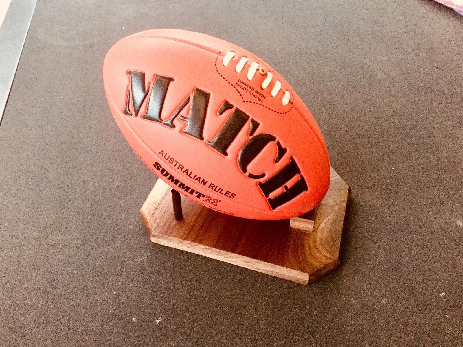 Display stand for footballs