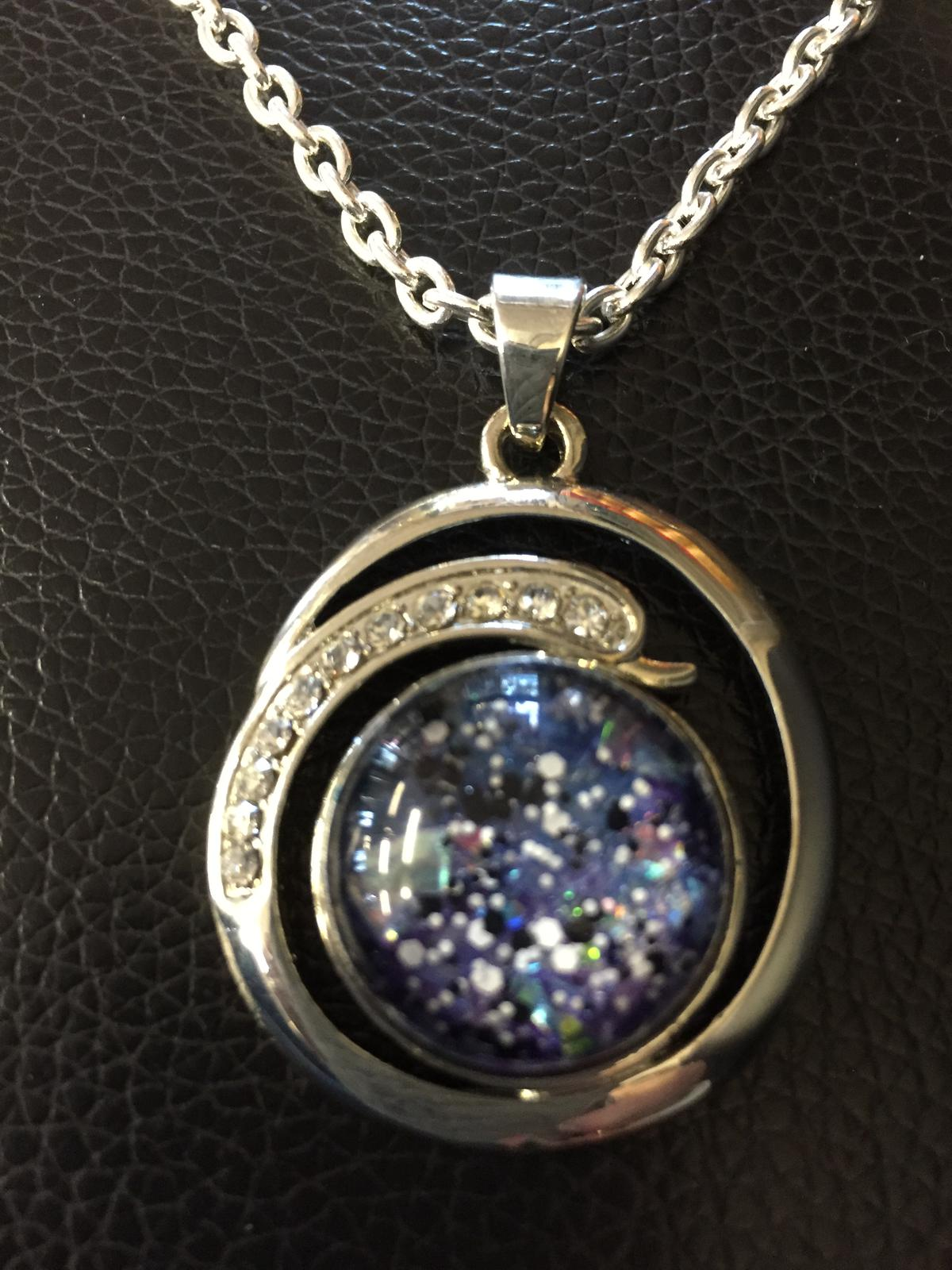 Pendant with insert