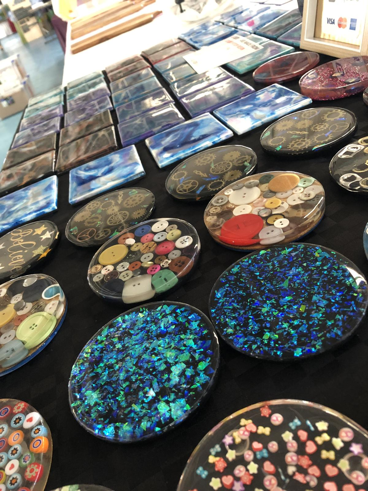 Some of the round and square coasters i sell. No 2 coasters are exactly alike so