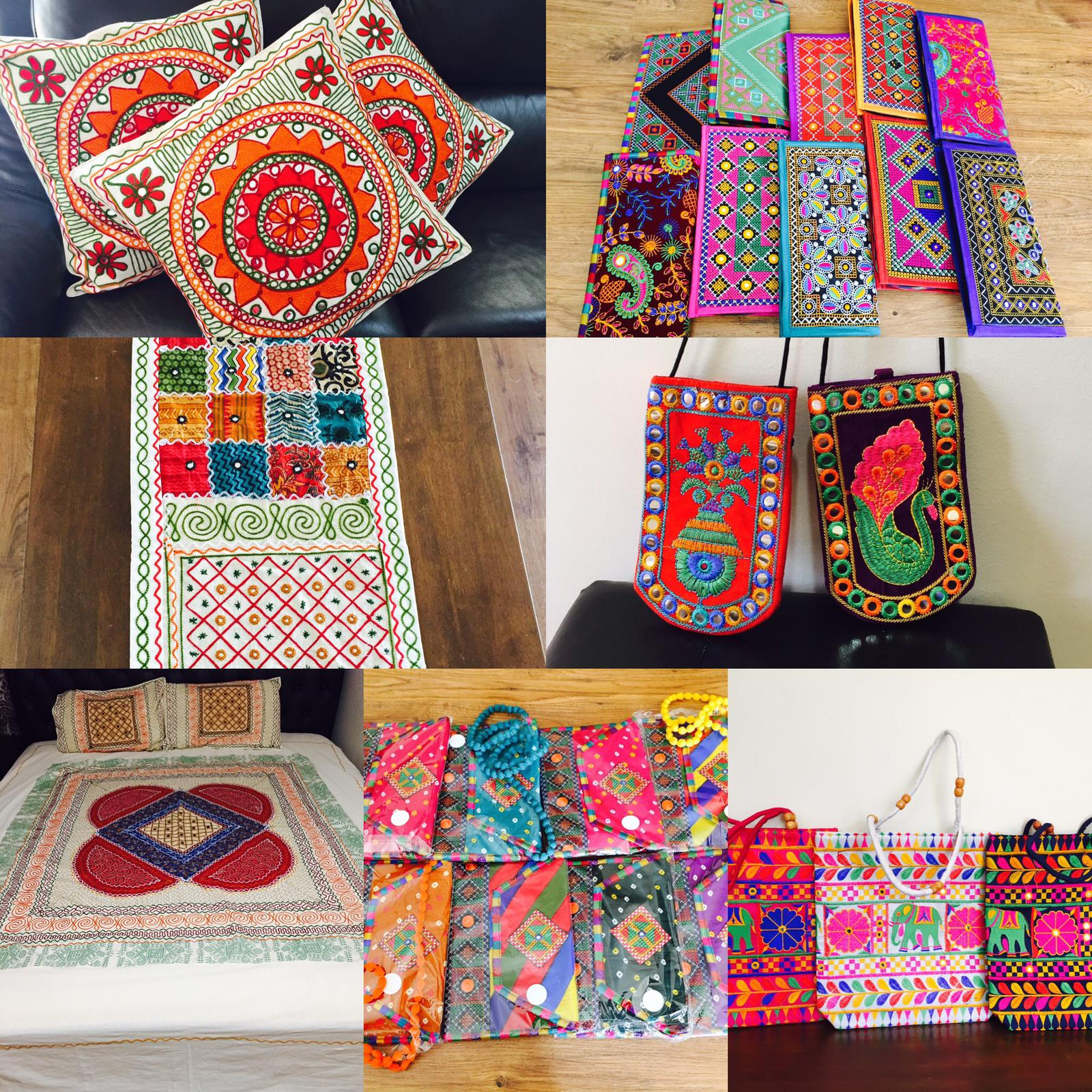 Handcrafted embroidered handbags,cushion covers, bedcovers , table runners.