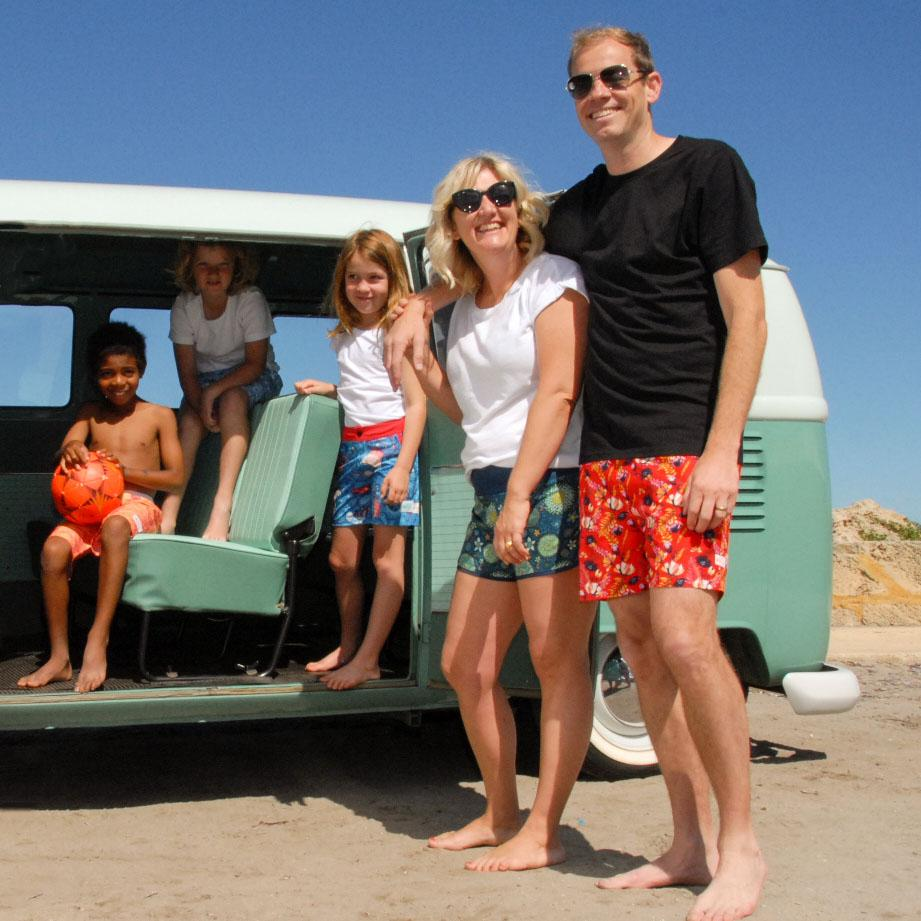 Family wearing South Beach Boardies made from recycled plastic bottles