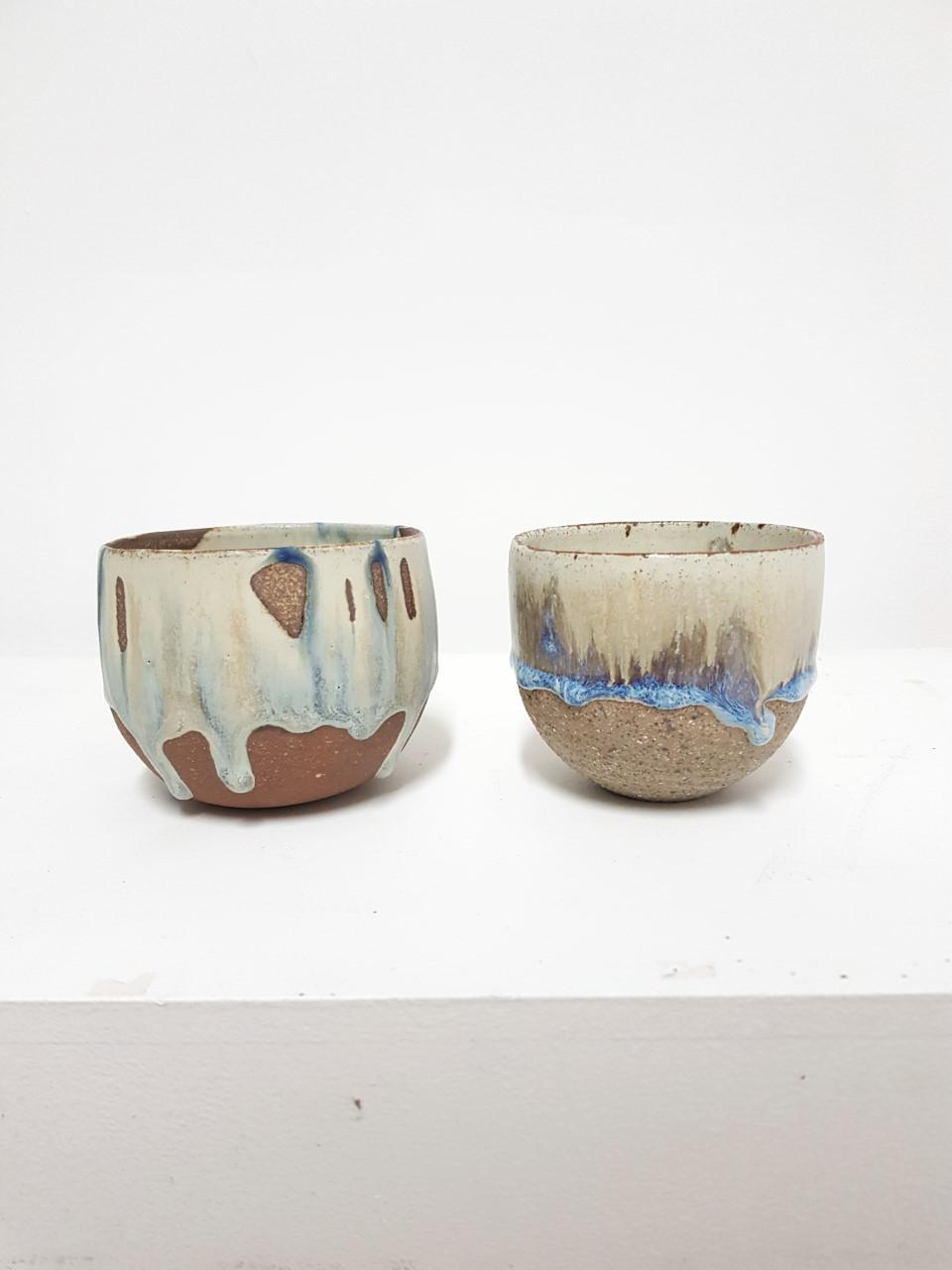 STONEWARE CUPS IN PATCH OF BLUE